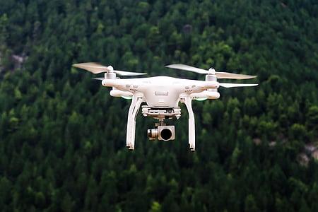 photo of white DJI Phantom 3 Standard taking flight during daytime