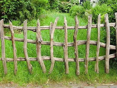 brown wooden fence near green grass