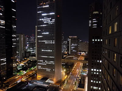photo of lighted high-rise building