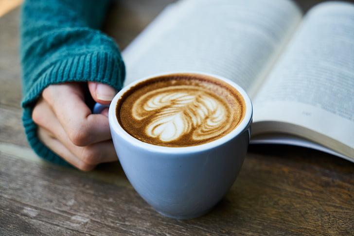 Royalty-Free photo: Person holding white ceramic mug with coffee latte | PickPik