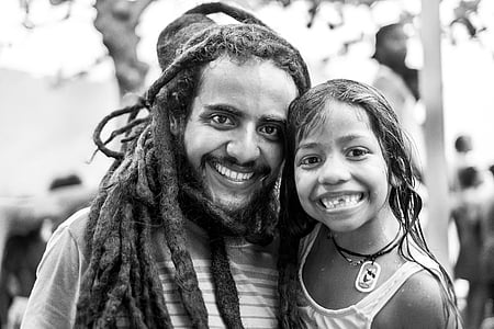 grayscale photography of man and girl