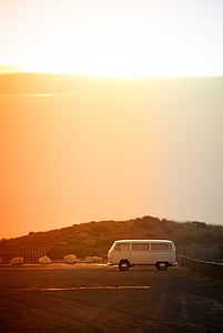 white van under golden hour during daytime
