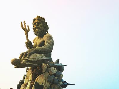 focus photography of Poseidon statue