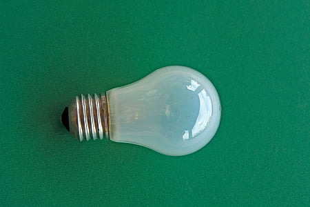 clear halogen bulb light on green surface