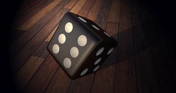 black dice on wooden floor