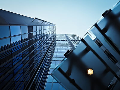 low angle photography of curtain wall high rise building under blue sky