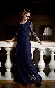 woman in blue dress posing for picture