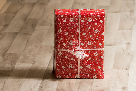 red and gray star print gift box on the floor