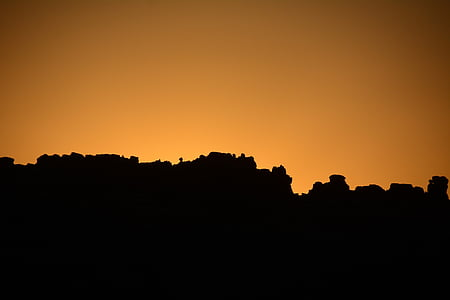silhouette photography of rock formation during golden hour