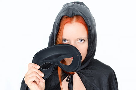 woman with red hair wearing black cowl