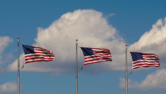three US flag on poles
