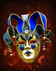 gold and blue Jester mask selective focus photography