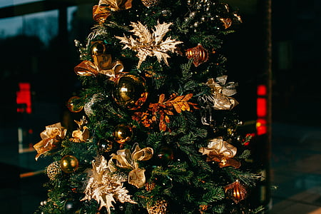 green Christmas tree with gold flower decors