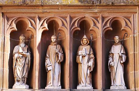 photo of four concrete statues