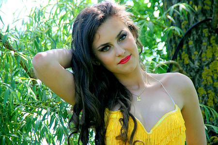woman wearing yellow fringe bra