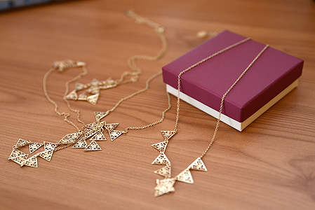 photo of gold-colored necklace
