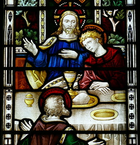 Jesus Christ beside saint stained glass window