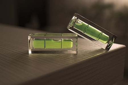 two clear glass spirit levels