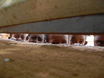 children peeping at boundary
