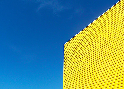 yellow painted building under blue sky during daytime