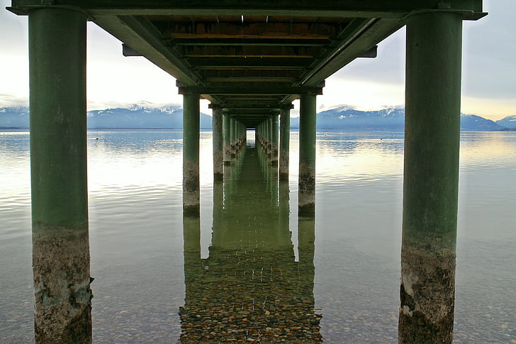 underneath dock photo during golden hour
