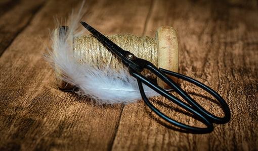 scissors on beige yarn