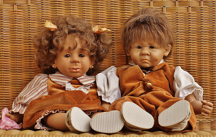 two boy and girl doll