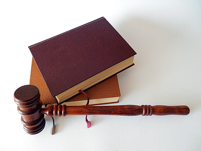 brown wooden gavel and two brown books