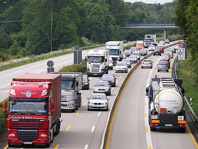trucks and cars on a road during daytime
