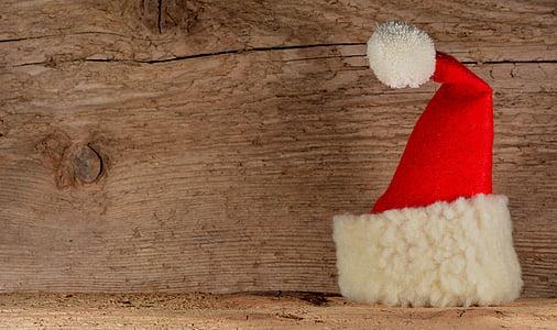 Santa hat on wooden surface