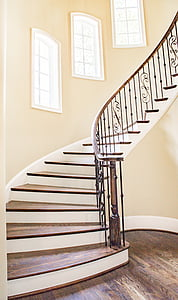 brown and white wooden spiral staircase