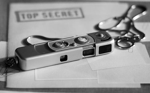 spy camera on top of Top Secret folder