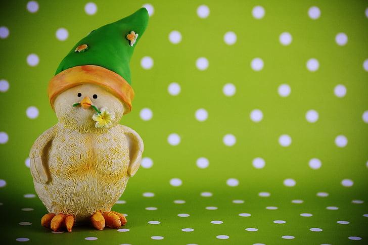 yellow chick wearing green hat