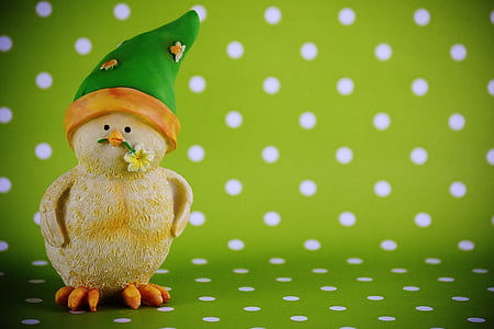 yellow chick wearing green hat