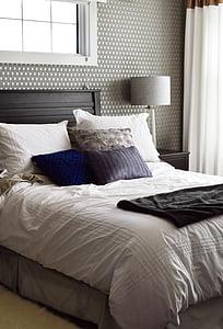 black bed frame with white comforter set