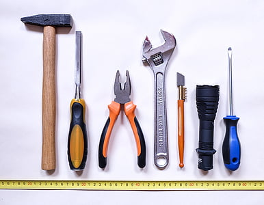 seven assorted hand tools with yellow tape measure bottom