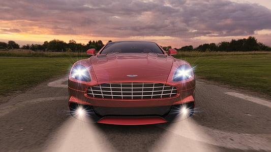 red car beside green grass field