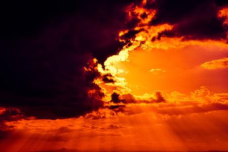sunlight peeking thru the clouds