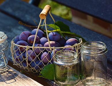 purple grape fruits on basket