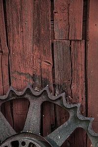 brown sprocket on brown wood surface