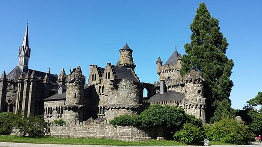 gray concrete castle under blue sky