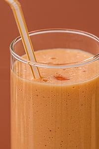 closeup photo of orange smoothie