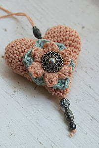 closeup photo of heart knit pendant