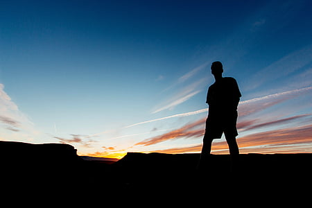 silhouette of person on hill
