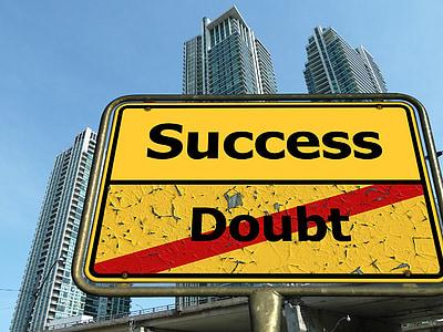 Success doubt road signage