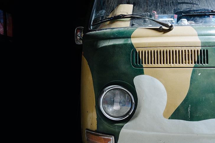 green and beige camouflage Volkswagen bus