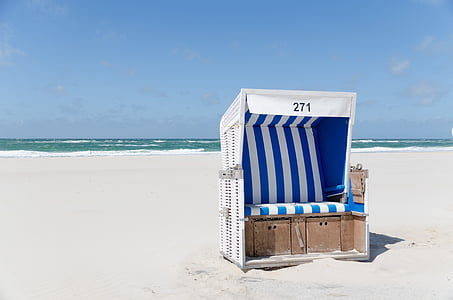 white and brown wooden stall in beach
