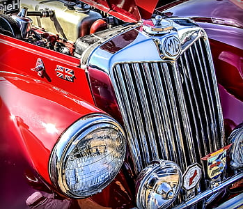 photo of classic red MG vehicle