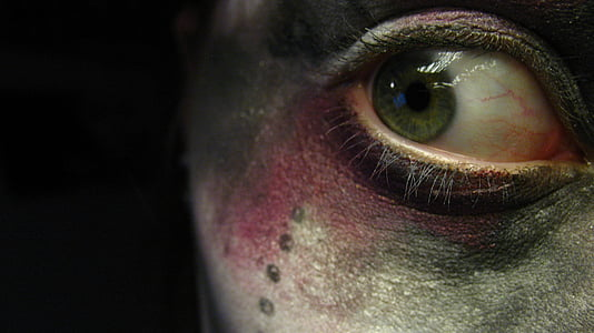 closeup photo of person's right eye