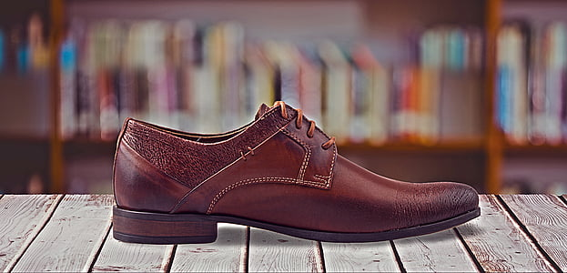 selective focus photography of brown leather dress shoe
